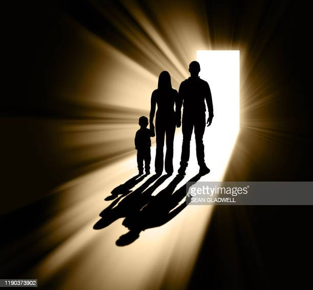 family in doorway silhouette - mystery stock pictures, royalty-free photos & images