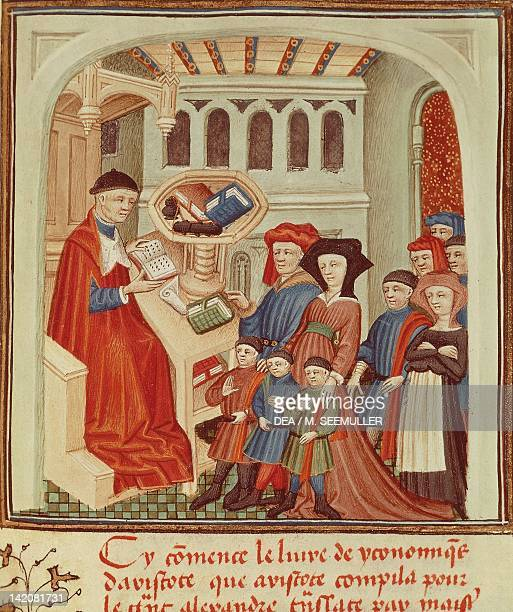 A family in front of a financier miniature from Ethics Politics the Economy by Aristotle France 15th Century