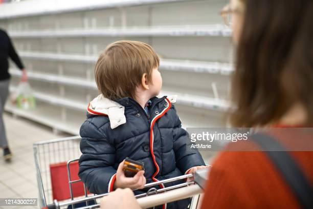 family in front of empty shelf in a supermarket - sold out stock pictures, royalty-free photos & images