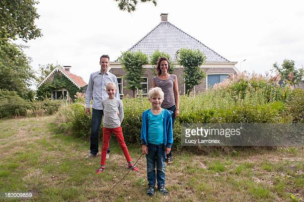 Family in front of farm house