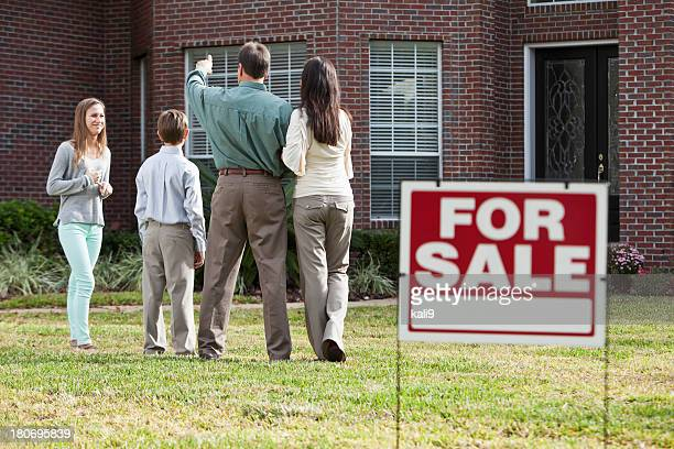 Family in front of home for sale