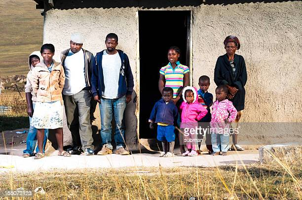 family in front of there hut - south african culture stock photos and pictures