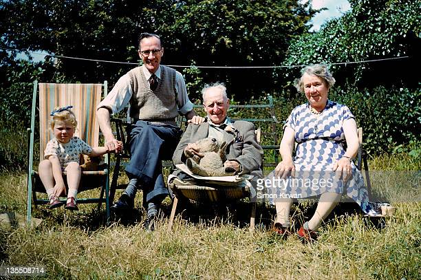 family in garden - archival stock pictures, royalty-free photos & images