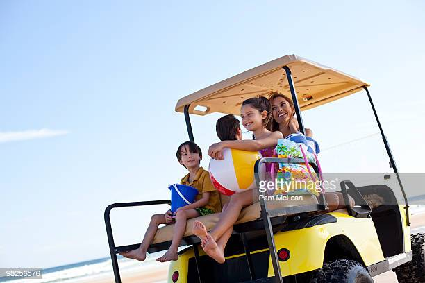 Family in golfcart