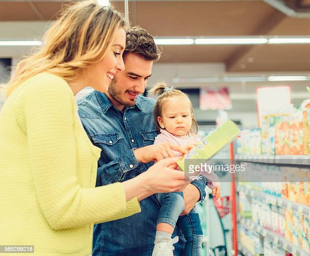 Family In Groceries Store