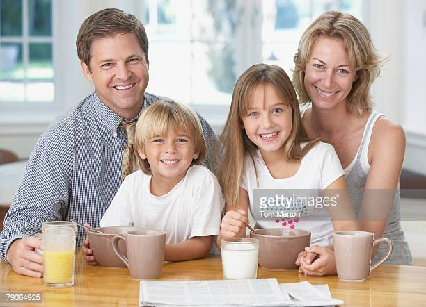 Family in kitchen having breakfast