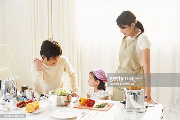 Family in kitchen, smiling
