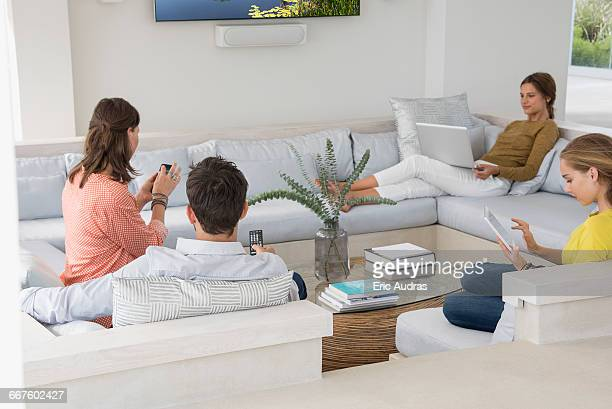 Family in living room busy in different activities