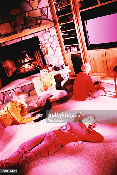 Family In Living Room Stock Photo | Getty Images