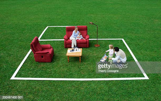 Family in living room plan on lawn, elevated view