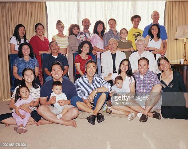 Family in living room smiling, portrait