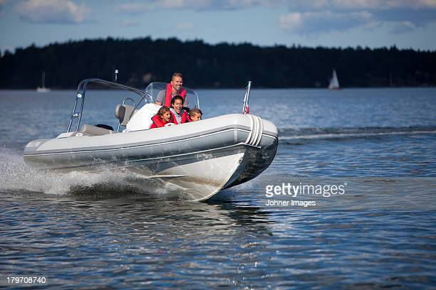 Family in motorboat