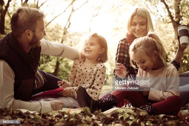 Family in park with two daughters.