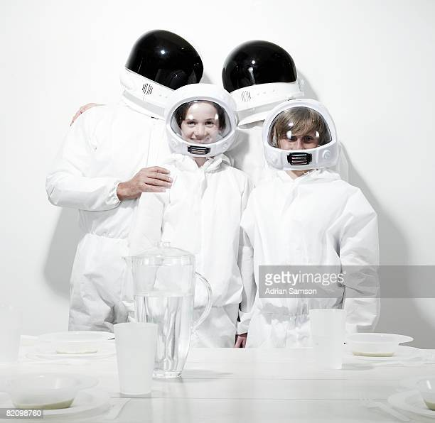 Family in protective suits