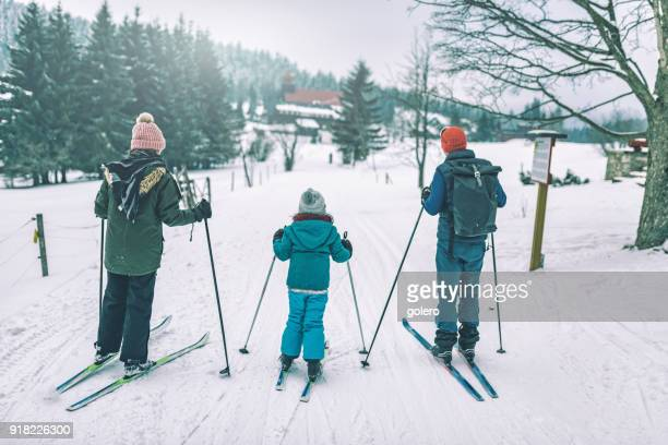 family in snowy winter landscape on cross-country-ski