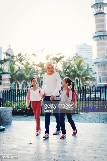 family in south east asia - vertical stock pictures, royalty-free photos & images