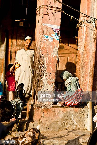 family in street corridor with goat - merten snijders stock pictures, royalty-free photos & images