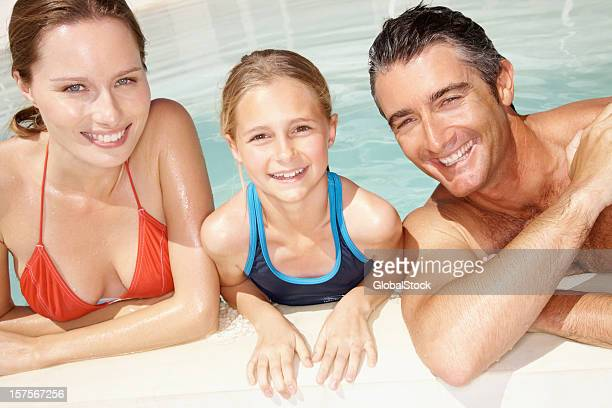 family in swimming pool on a vacation - little girl cleavage stock photos and pictures