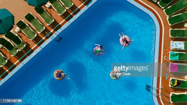 family in swimming pool on holiday - spain stock pictures, royalty-free photos & images