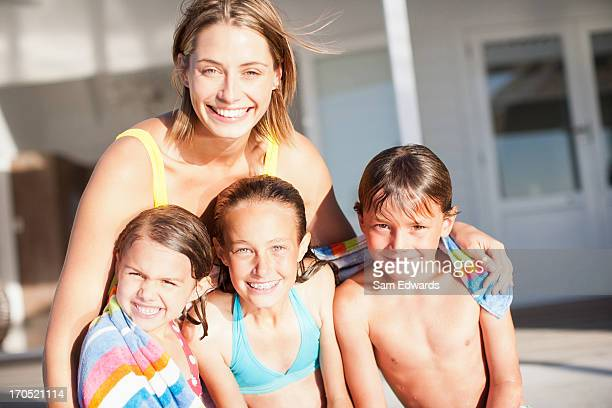 family in swimwear - aunt stock pictures, royalty-free photos & images