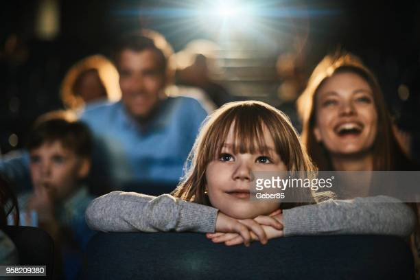 family in the cinema - arts culture and entertainment stock pictures, royalty-free photos & images