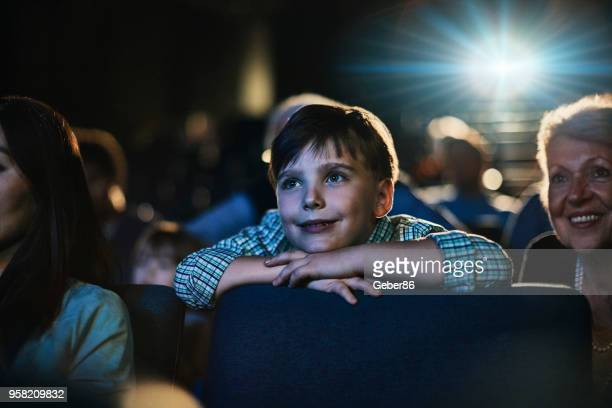 family in the cinema - children theatre stock photos and pictures