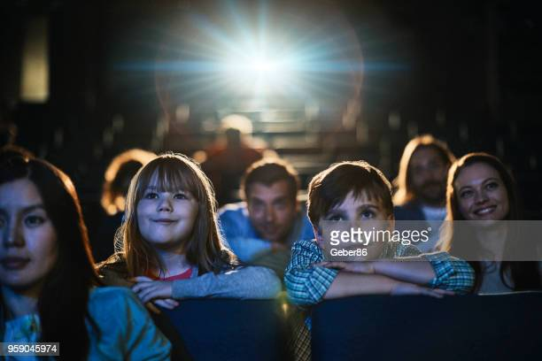 family in the cinema - film and television screening stock pictures, royalty-free photos & images