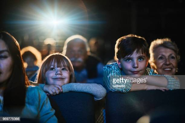 family in the cinema - film industry stock pictures, royalty-free photos & images