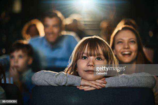 family in the cinema - film screening stock pictures, royalty-free photos & images