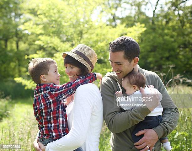 a family in the countryside - delahaye stock photos and pictures
