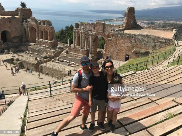 Family in the Greek theater of Taormina