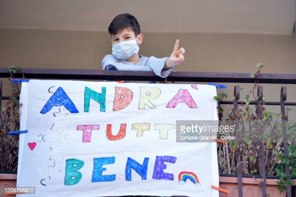 Family in the house for closed school and interrupted work due to the government ordinance to avoid Coronavirus infection, writes and paints a banner...