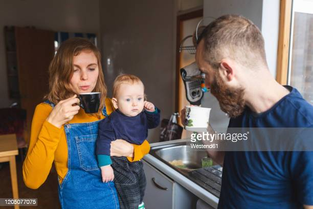 family in the kitchen at home - baby stock pictures, royalty-free photos & images
