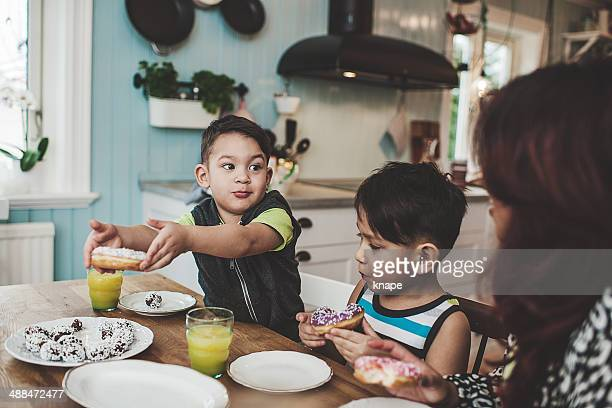 Family in the kitchen eating sweet food