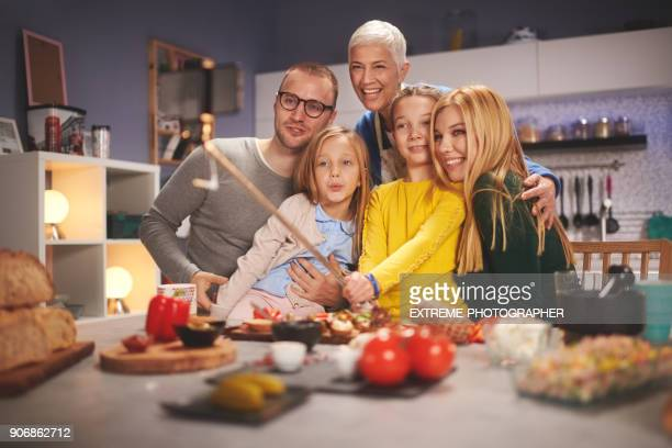 family in the kitchen - fat granny stock pictures, royalty-free photos & images