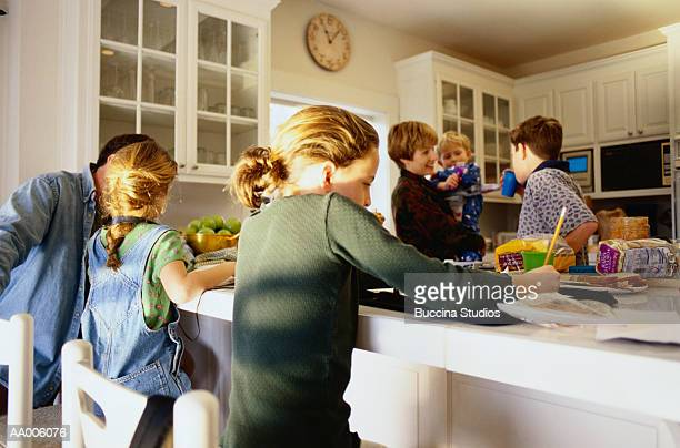 family in the kitchen - large family stock pictures, royalty-free photos & images