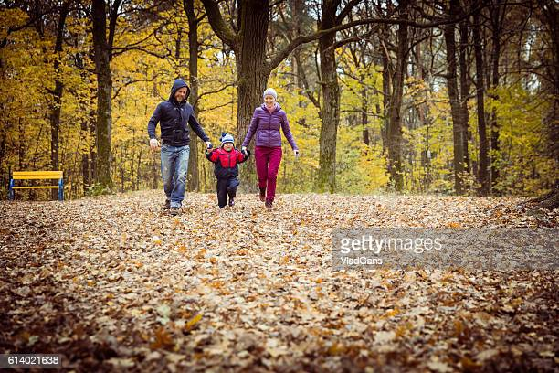 Family in the park in autumn day