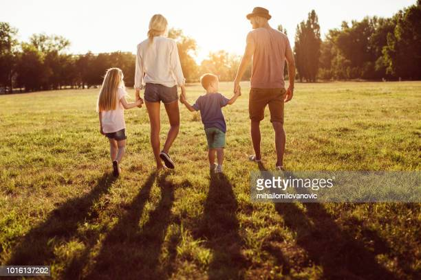 family in the park - natural parkland stock pictures, royalty-free photos & images