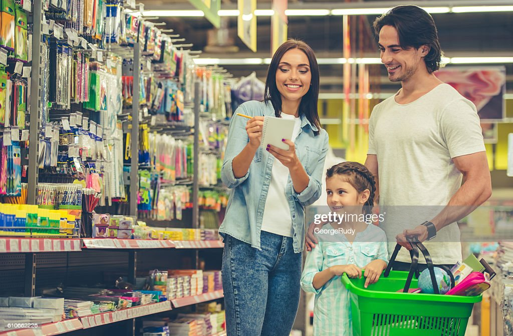 Family in the supermarket : Stock Photo