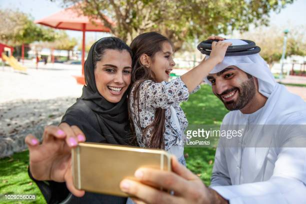Family in the UAE having fun outdoor at the public park