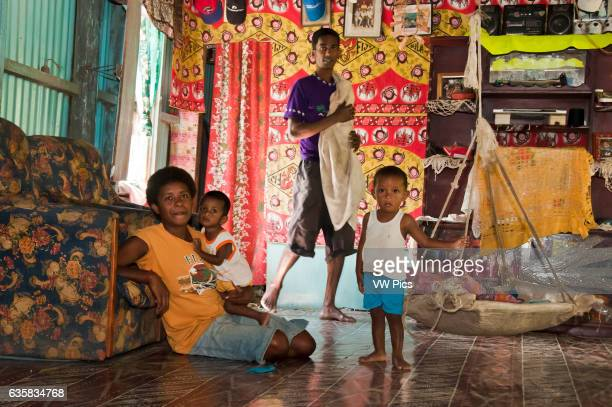 Family in their bure in the village of Naveyago on the Sigatoka River Viti Levu Island Fiji