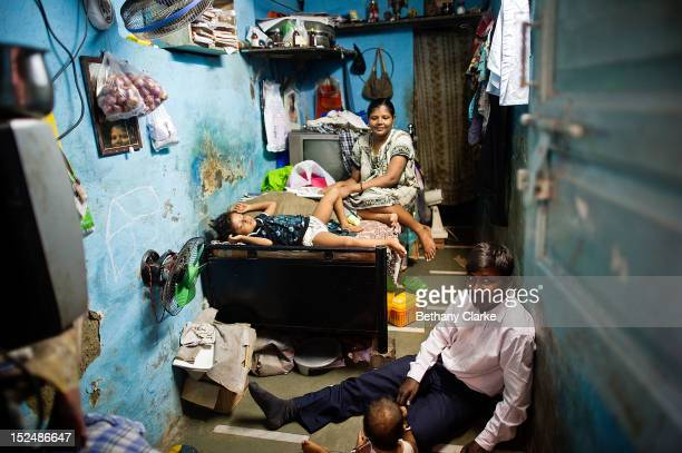 A family in their home in Dharavi November 4 2011 in Mumbai India Dharavi Asia's largest slum situated in the centre of Mumbai One million people...