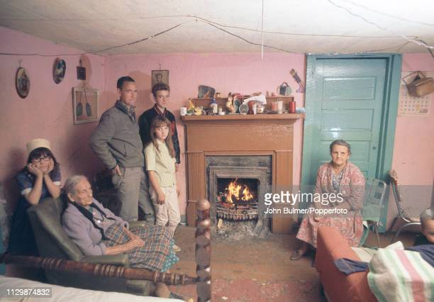 A family in their living room near a open coal fireplace Pike County Kentucky US 1967