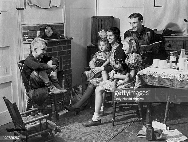Family in their new prefabricated house 24 October 1944 'Mr and Mrs John Green and their family are the first to occupy a prefabricated hut house in...