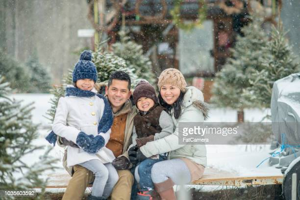 family in winter - filipino christmas family stock pictures, royalty-free photos & images