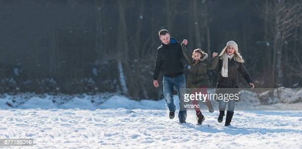 family in winter - winter family stock photos and pictures