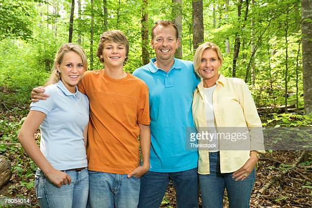 Family in woods