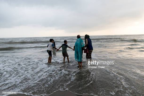 Cox´s Bazar Bangladesh October 14 2018 A family is enjoying the sunset at the beach The beach of Cox's Bazar wIth 120 km long sandy beach it is a...