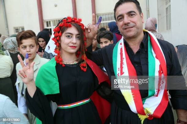 A family is pictured at the poll station after they both casted their vote September 25 2017 is a historic day for Kurdish people around the world as...