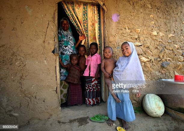 A family is seen outside their mud and brick home on November 07 2009 in Bauchi Nigeria